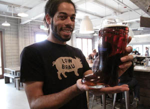 Server Dante Griffin at LowBrau shows how you can give Sacramento Beer Week the boot—with a glass boot-shaped stein filled with a liter of your favorite suds.Photo: Nick Miller